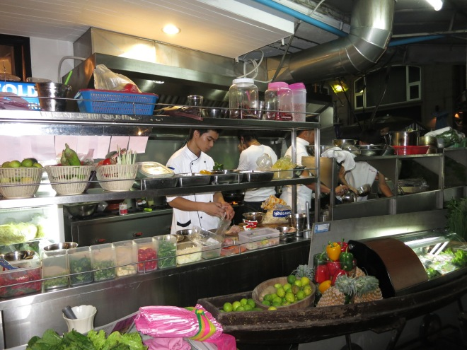 Thai cook in a street restaurant in Bangkok.