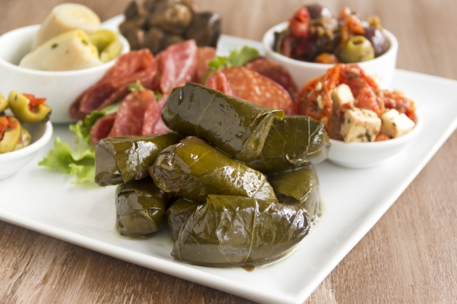 Greek dolmades wrapped with vine leaves feature in a mezze platter_resize