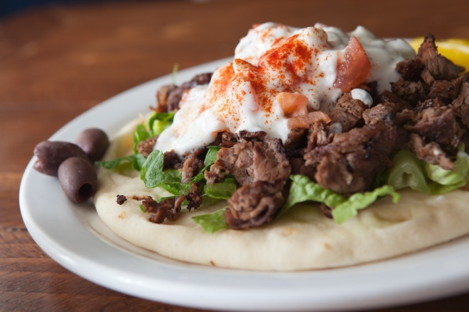 Authentic gyro on a plate filled with rich flavorful ingredients_resize